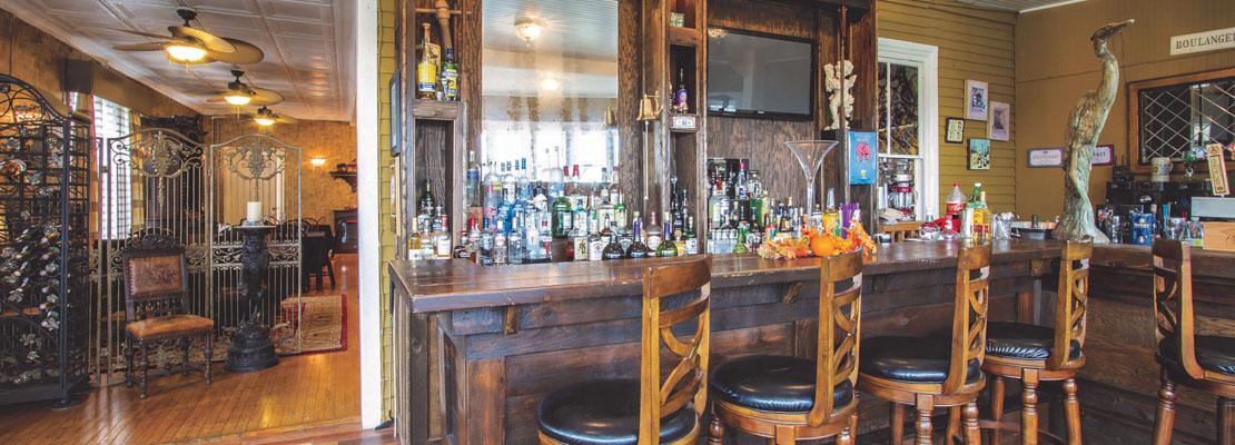 Lavish wooden bar and stools