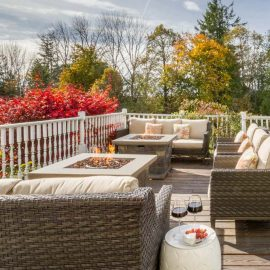 Outdoor patio furniture and a fire pit on a deck
