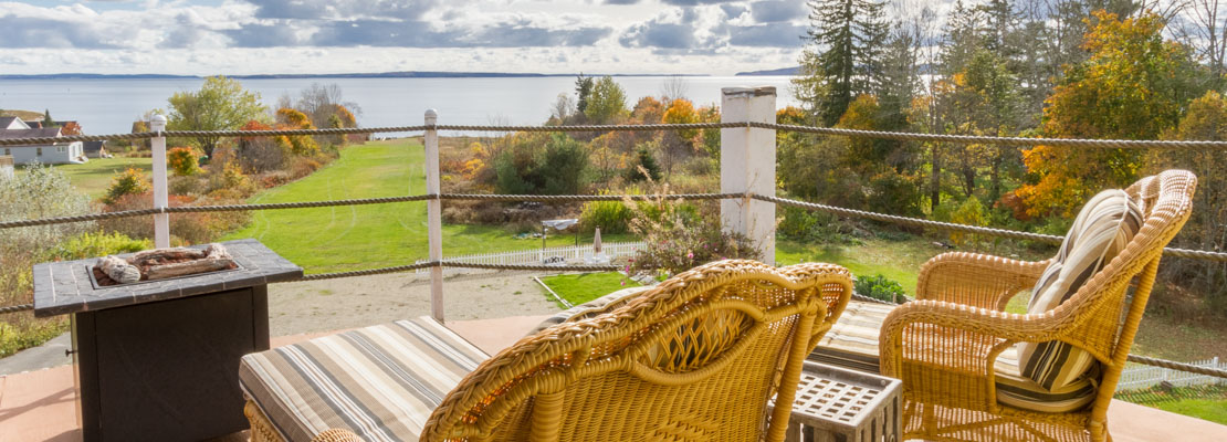Stunning bay views from a balcony at our bed and breakfast
