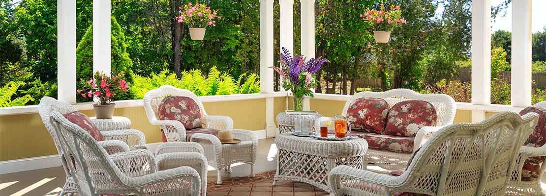 White wicker chairs in an open porch