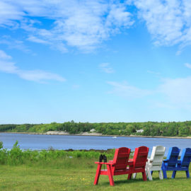 Adirondack chairs by the sea