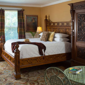 Lavish wooden bed in the Captain's Suite