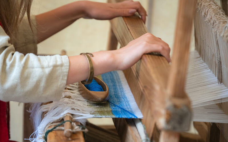 Woman weaving at Maine Craft Fair