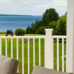 Private deck overlooking an expansive lawn and the Maine coast