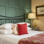 Queen bed with two end tables at our Searsport B&B