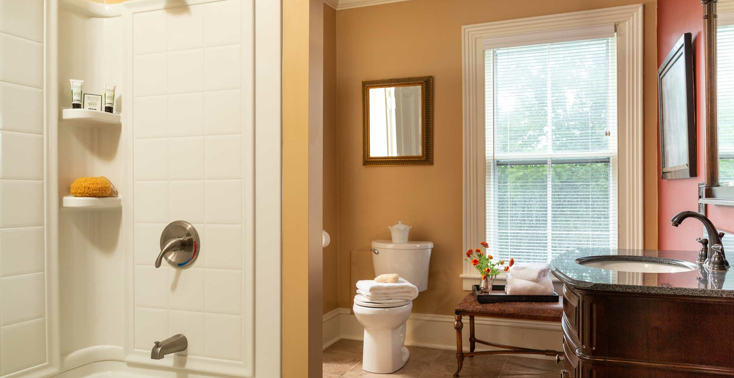Spacious bathroom with a shower and tub and window