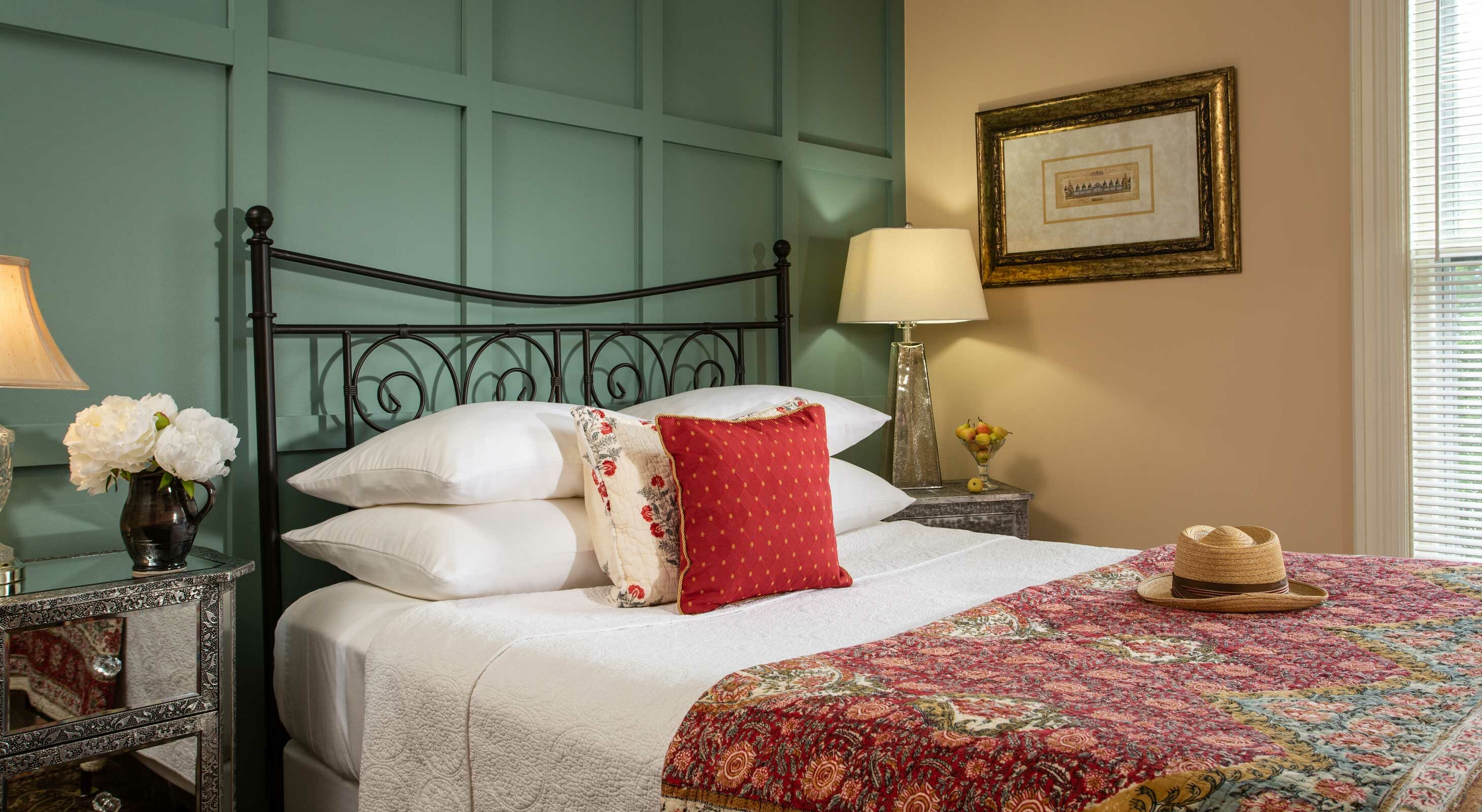 Queen bed with two end tables at our Maine bed and breakfast