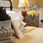 Wrought iron king bed with pillows and end tables with lamps at our Maine Coast B&B