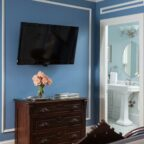 View of the TV and bathroom entrance from Queen bed