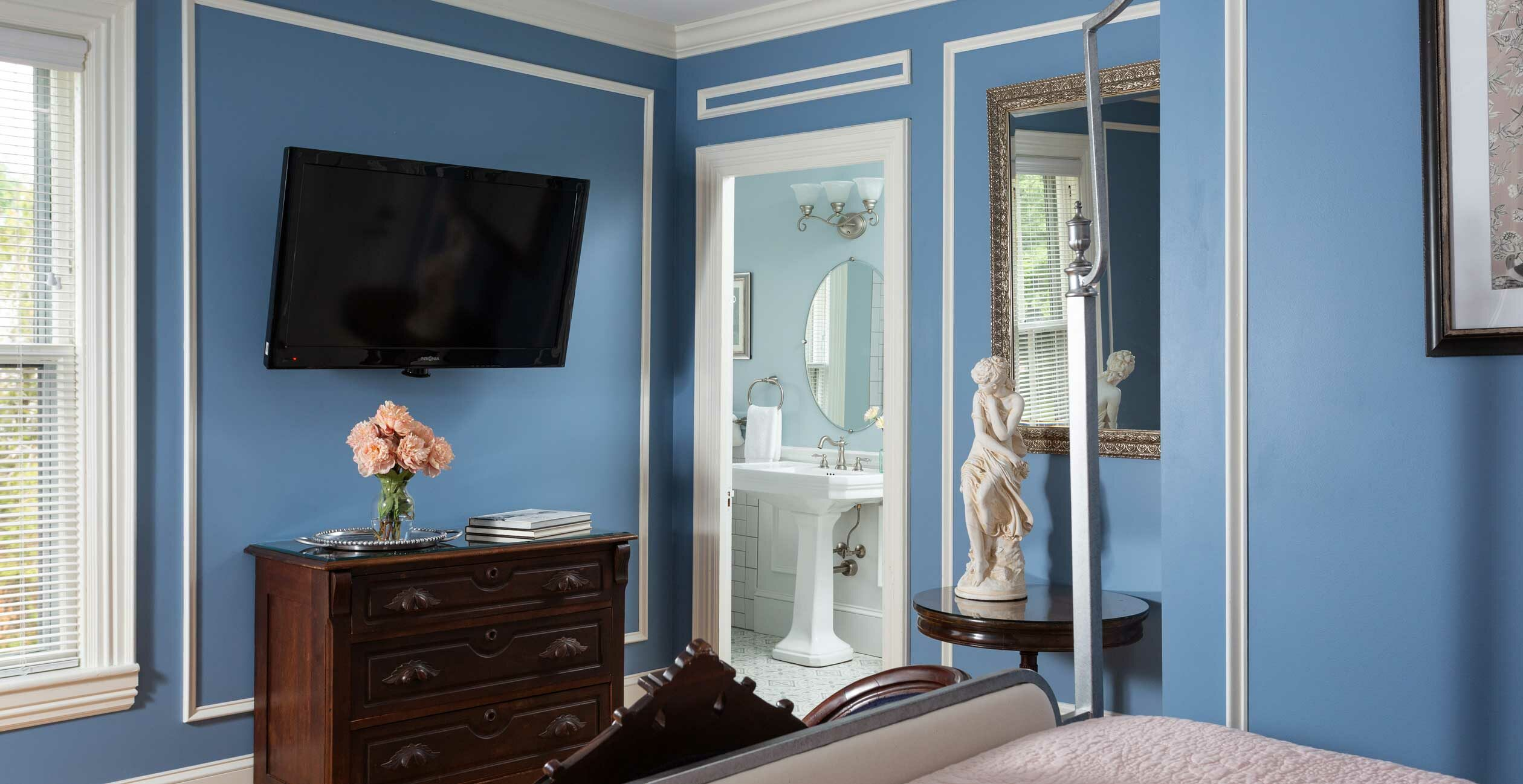 View of tv and bathroom from the queen bed