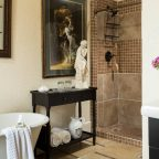 A large bathroom with a clawfoot tub and walk-in shower