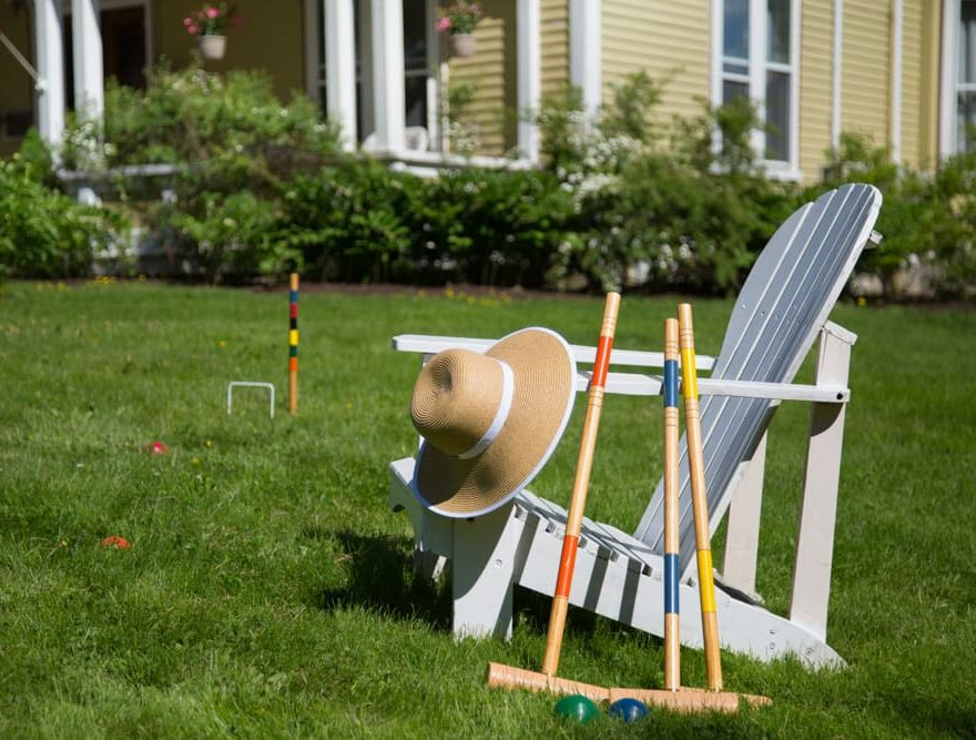 Croquet set resting on a white chair at our Maine B&B