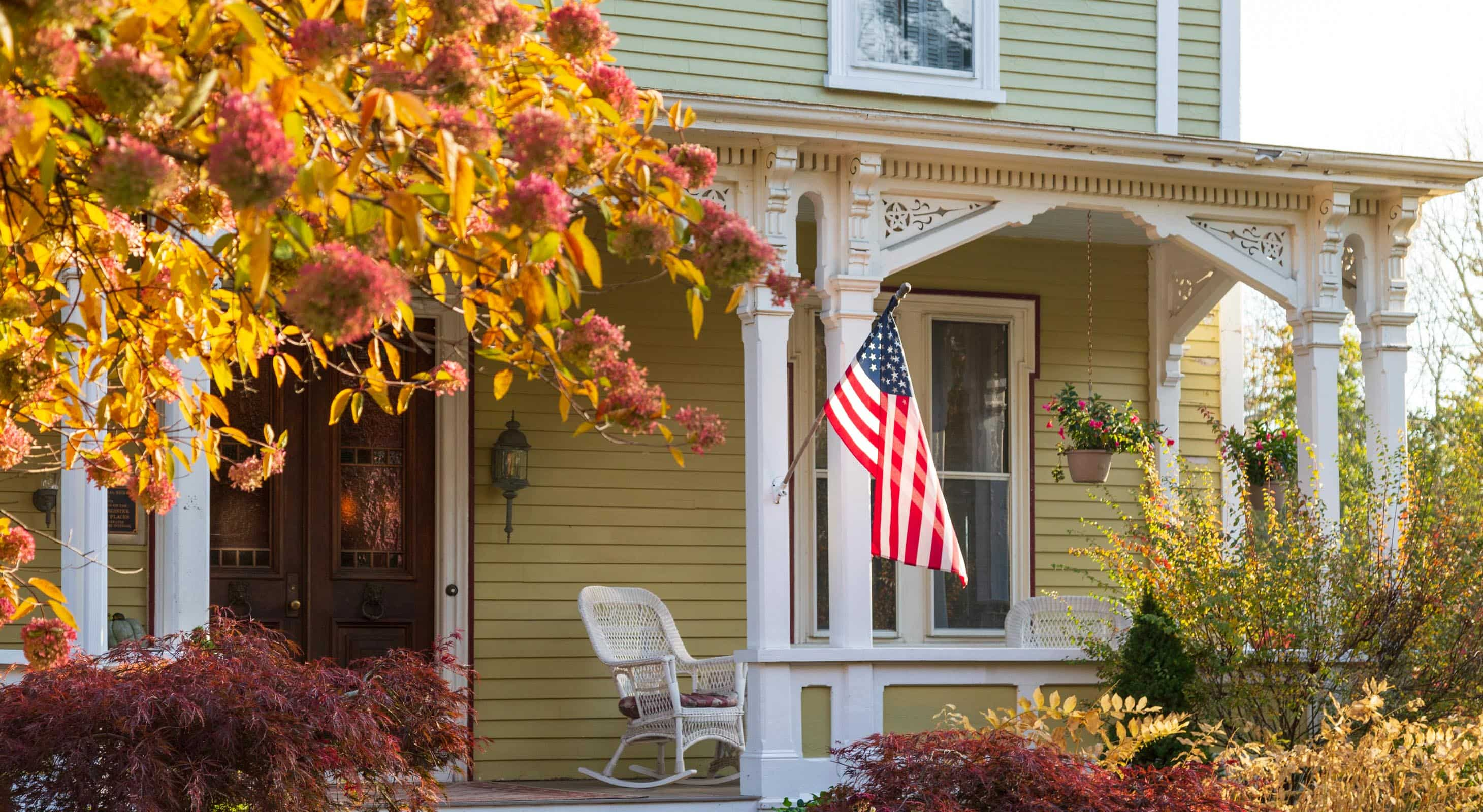 Captain Nickels Inn front porch with an American Flag posted in the front