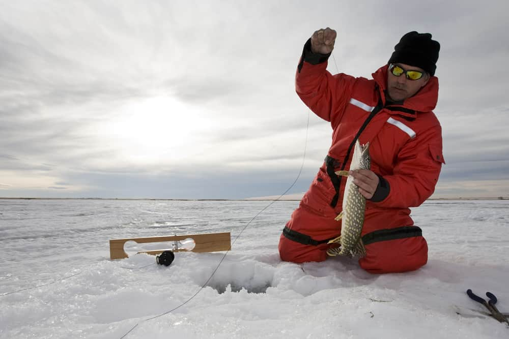 Man caught a fish while ice fishing