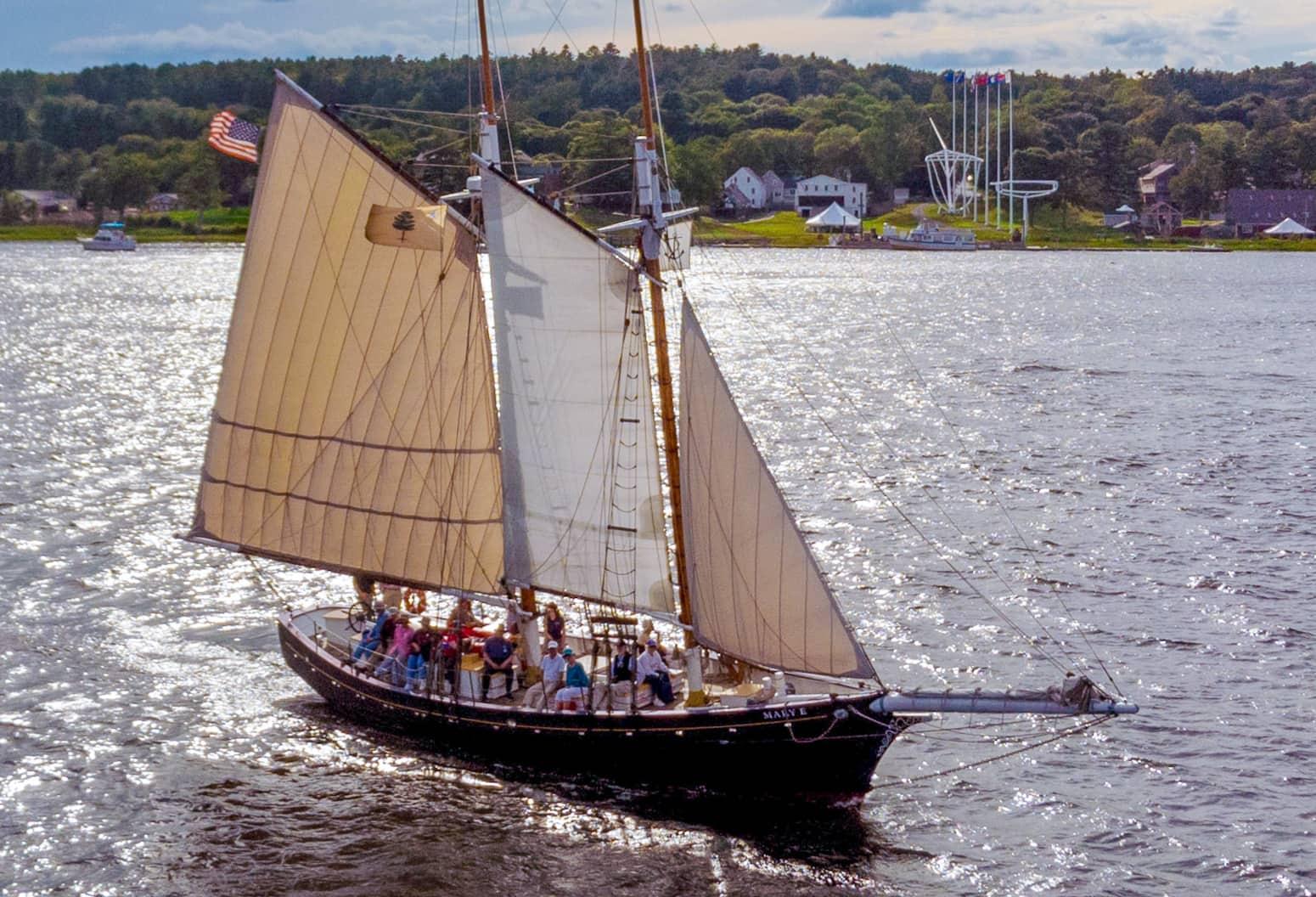 A historic ship sailing of the coast of Maine