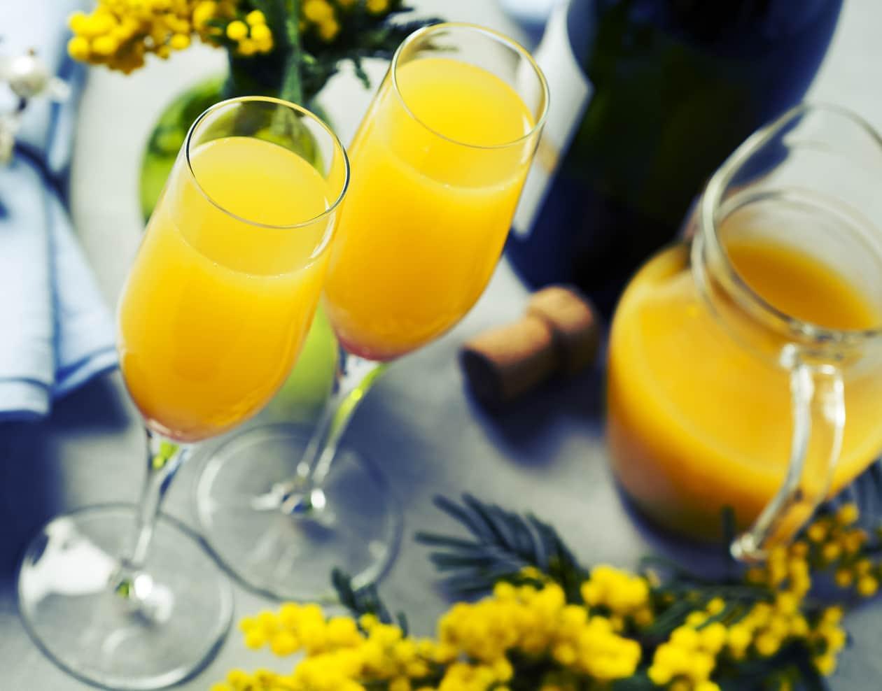Bottle of champagne and orange juice mimosas