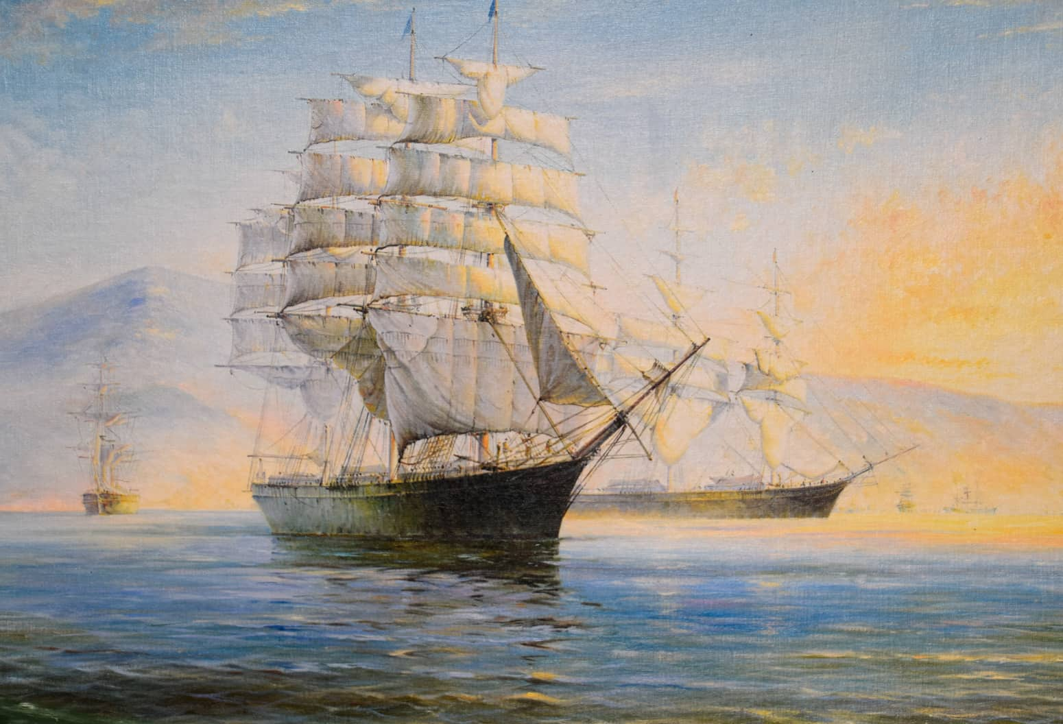 A painting of an old ship at sea