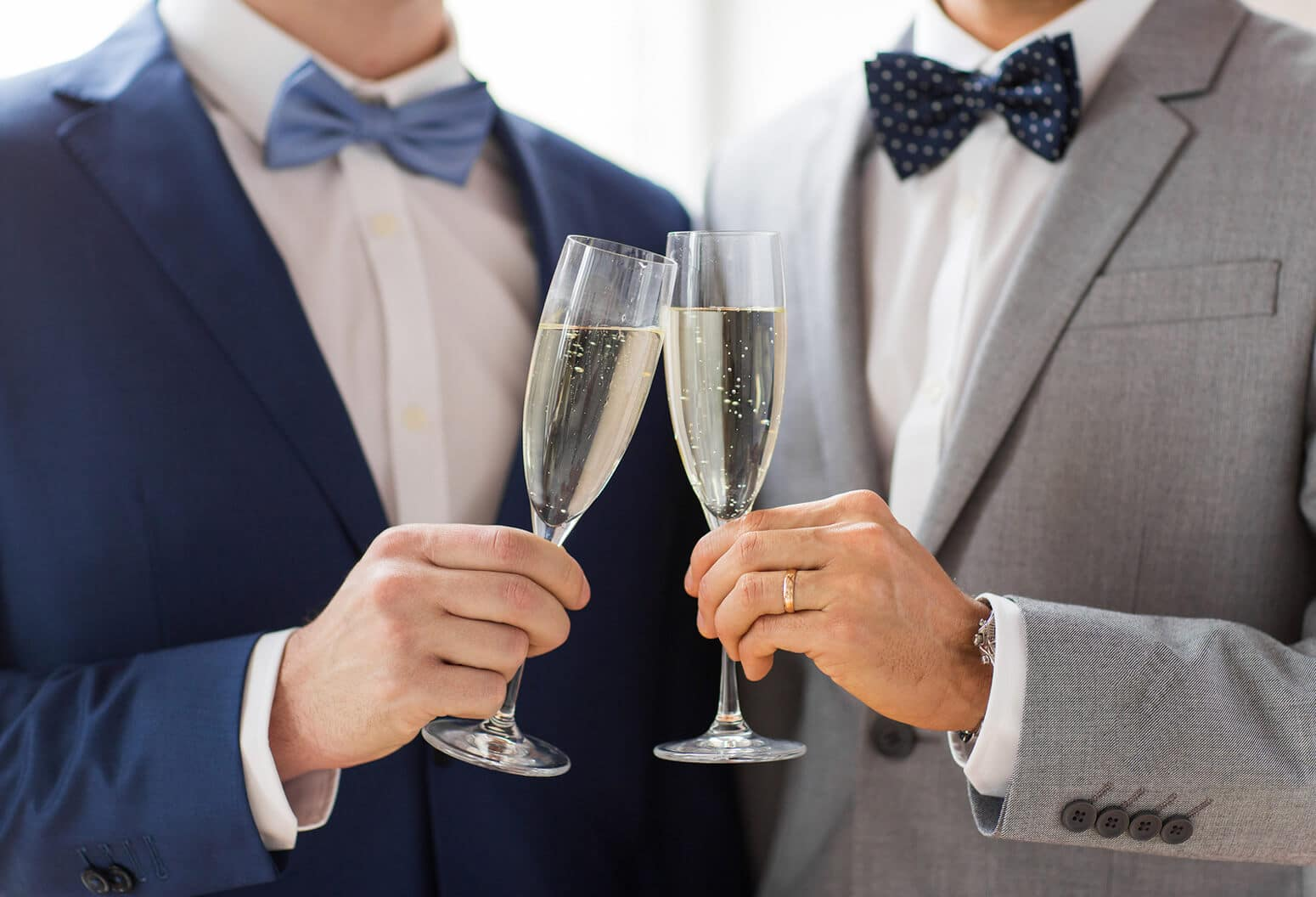 gay couple at wedding with Champagne