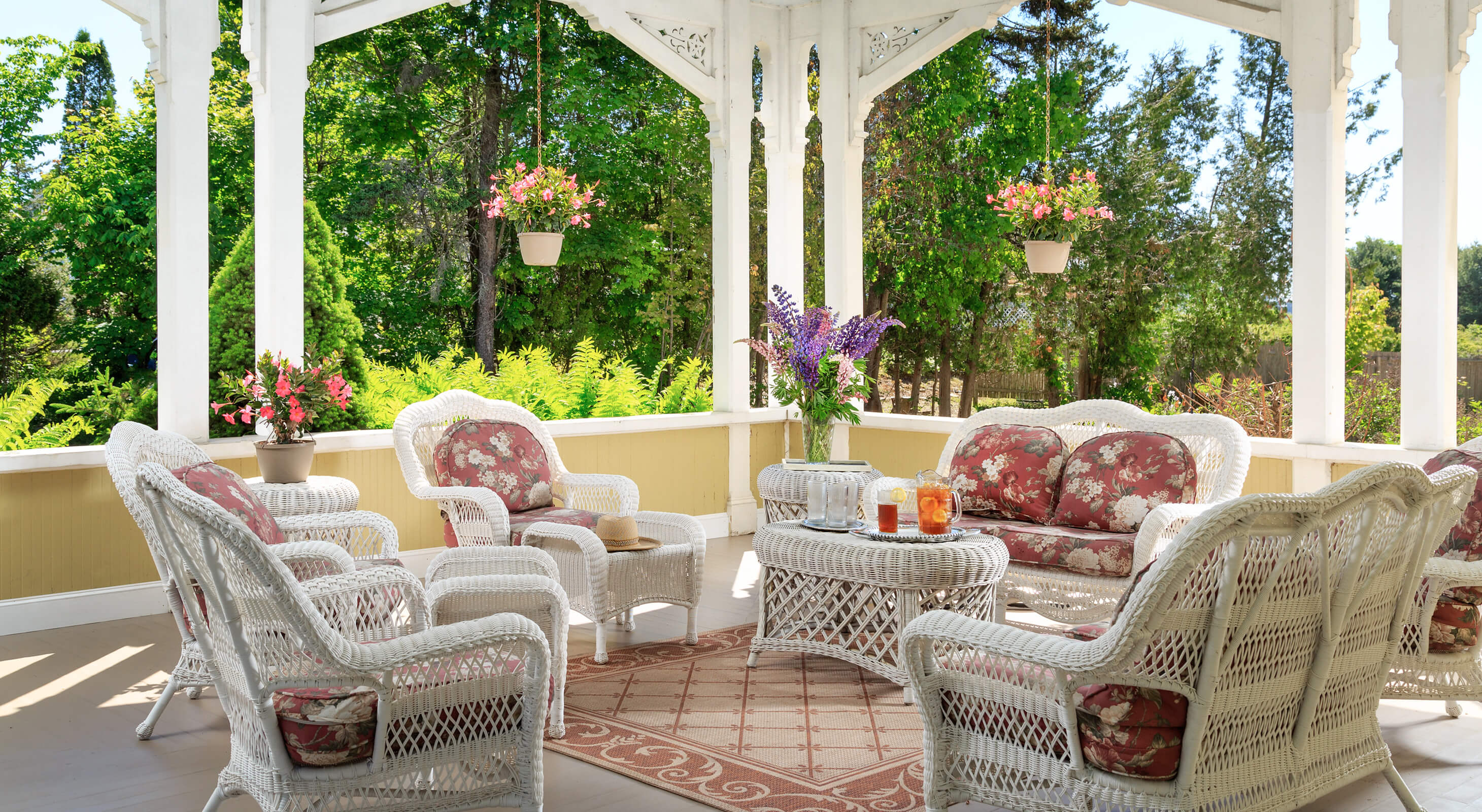 Relaxing large porch with wicker furniture