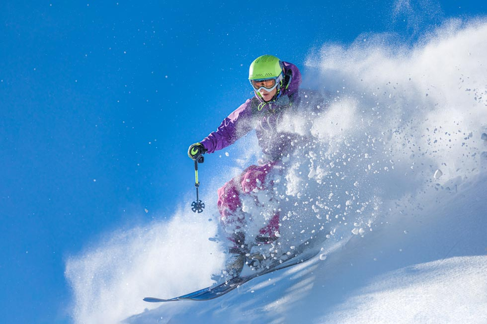 alpine skier busting powder at Camden Snow Bowl