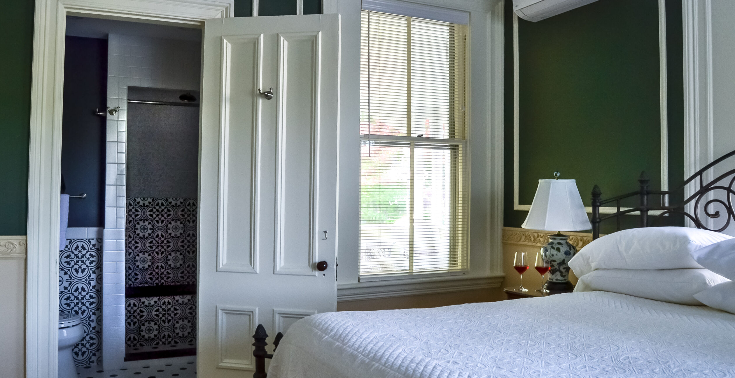 View of room and doorway to bathroom from bed