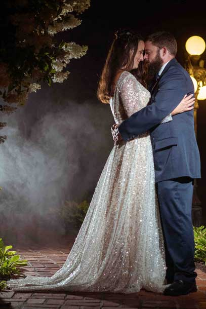 Bride And Groom embrace in the evening mist